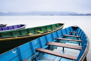 Phewa Lake as Multi-Colored Boats Stand by for Tourists Near Pokhara, Nepal by Sergio Ballivian