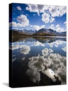Reflections of Mt. Tuni Condoriri in the Cordillera Real, Bolivi by Sergio Ballivian