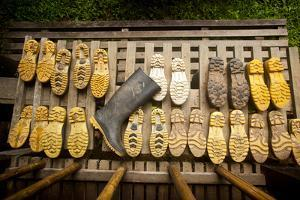 Rubber Boots Dry Out at a Lodge in Tambopata Reserve in Peru's Amazon Basin by Sergio Ballivian