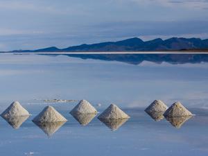 Salt Pyramids Wait for the Sun in a Flooded Salf Flat in Uyuni, by Sergio Ballivian
