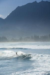 Surfers Riding Big Waves on the North Shore of Kauai, Hawaii in Hanalei Bay by Sergio Ballivian