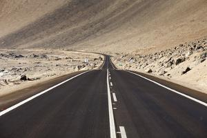 The Panamerican Highway Slices Through the Northern Atacama Desert in Northern Chile by Sergio Ballivian