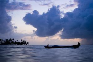Two Men on a Fishing Boat in the San Blas Islands of Panama at Sunset by Sergio Ballivian