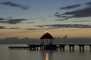 A Pier with a Gazebo and Benches for Relaxation at Dusk by Sergio Pitamitz