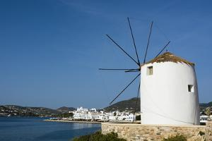 A Scenic View of the Parikia Waterfront and a Traditional Windmill by Sergio Pitamitz