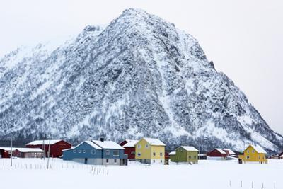Colorful Houses in Front of a Mountain in Winter by Sergio Pitamitz