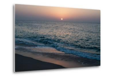 Sunset in Ras Al Hadd, Oman, and the Junction of the Gulf of Oman and Arabian Sea