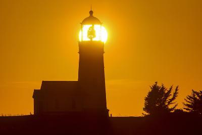 Setting Sun Behind Oregons Oldest Lighthouse at Cape Blanco Sp, Oregon-Chuck Haney-Photographic Print
