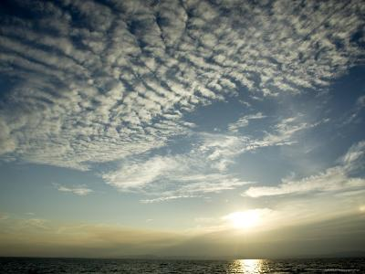 Setting Sun over the Sea with Cloud Filled Sky, Belize-Tim Laman-Photographic Print