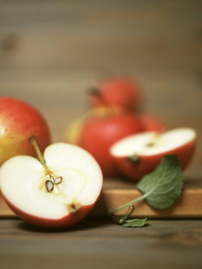 Several Apples, One Halved-Uwe Bender-Photographic Print