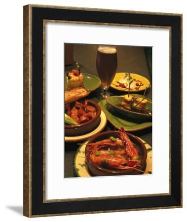 Several Dishes of Tapas and a Beer in a Spanish Restaurant-Richard Nowitz-Framed Photographic Print