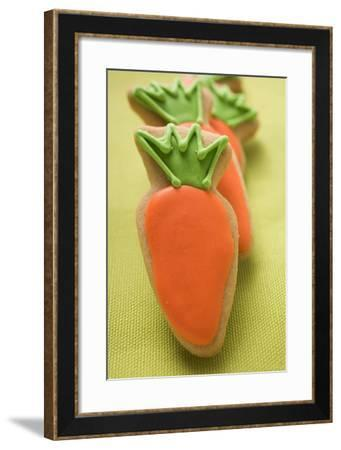 Several Easter Biscuits (Carrots) on Linen Background-Foodcollection-Framed Photographic Print