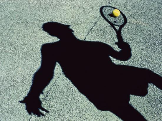 Shadow of a Male Tennis Player Playing Tennis--Photographic Print