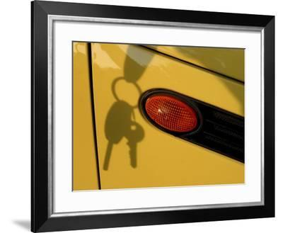 Shadow of Keys Against a Yellow Car--Framed Photographic Print