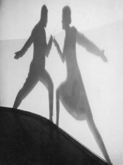 Shadow of Man and Woman Fencing--Photographic Print