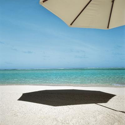 Shadow of Umbrella on the Beach--Photographic Print