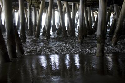Shady Patterns of Pilings and the Sea under the Boardwalk of the Pier-Stephen St^ John-Framed Photographic Print