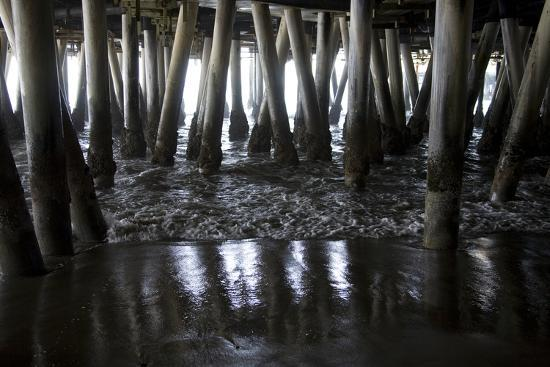 Shady Patterns of Pilings and the Sea under the Boardwalk of the Pier-Stephen St^ John-Photographic Print