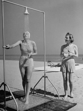 https://imgc.artprintimages.com/img/print/shapely-sunbather-taking-an-outdoor-shower-as-woman-preparing-for-her-turn-looks-on-at-beach_u-l-p766c10.jpg?p=0