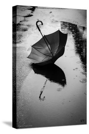 Umbrella in Puddle