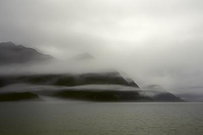 A Foggy Mist Layers the Mountains of Resurrection Bay in Alaska by Sheila Haddad