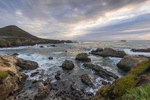 Cove of rocks and waves along Big Sur coastline with stormy skies by Sheila Haddad