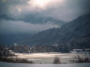 Light in the Winter Storm over Frozen Lake by Sheila Haddad