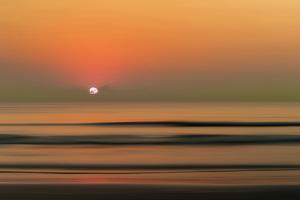 Sunset over Rippled Water by Sheila Haddad