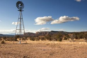 Windmill in New Mexico Landscape by Sheila Haddad
