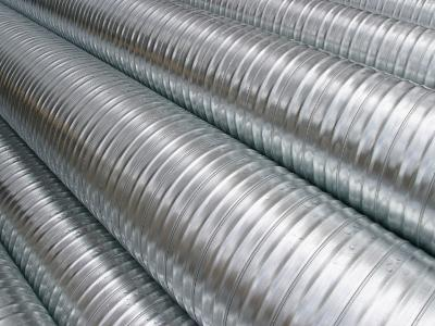Shiny Metal Piping Stacked in Pile--Photographic Print