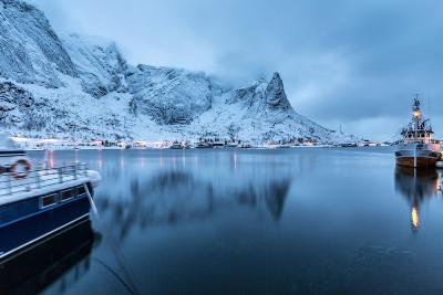 Ships Moored in the Small Harbor of Reine under a Gloomy Sky in the South of the Lofoten Islands-Roberto Moiola-Photographic Print