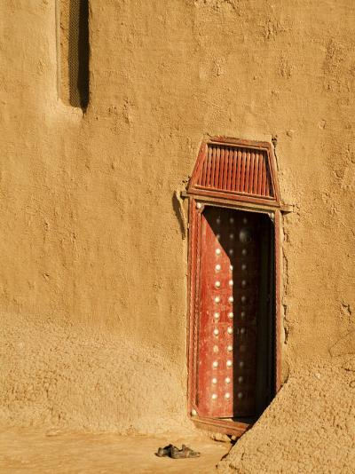 Shoes outside side door into the Mosque at Djenne, Mali, West Africa-Janis Miglavs-Photographic Print