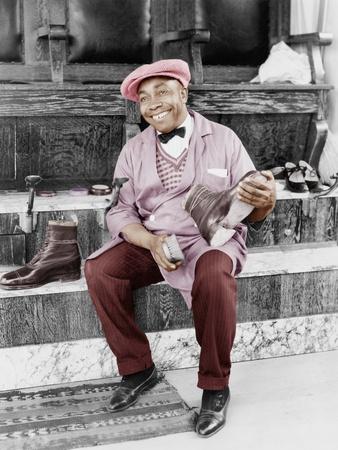 https://imgc.artprintimages.com/img/print/shoeshine-man-working-and-smiling_u-l-q1bwptx0.jpg?p=0