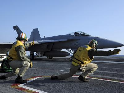 Shooters Aboard the USS George H.W. Bush Give the Go-Ahead Signal to Launch an F/A-18 Super Hornet-Stocktrek Images-Photographic Print