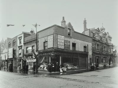 Shops and Sign to Putney Roller Skating Rink, Putney Bridge Road, London, 1911--Photographic Print