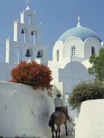 Figure on Donkey Passing Church Bell Tower and Dome, Vothonas, Santorini, Cyclades Islands, Greece