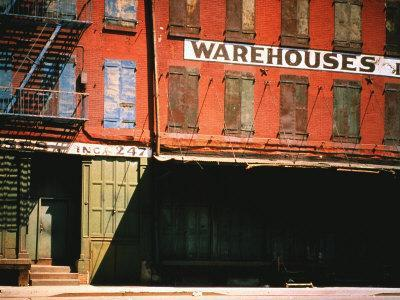 https://imgc.artprintimages.com/img/print/shuttered-warehouse-on-the-lower-east-side-lit-by-late-day-sunlight_u-l-p3pg8p0.jpg?p=0