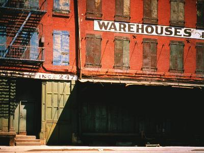 Shuttered Warehouse on the Lower East Side Lit by Late Day Sunlight-Walker Evans-Photographic Print