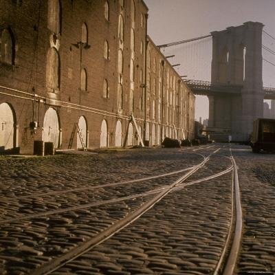 Shuttered Warehouses Lit by Sunlight on Trolley Track Railed Street Along Brooklyn Waterfront-Walker Evans-Photographic Print
