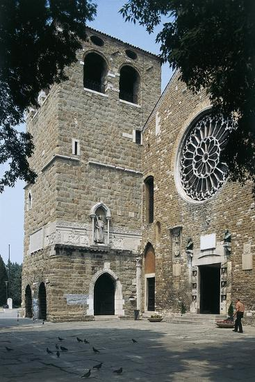 Side Profile of a Senior Man Walking in Front of a Basilica--Photographic Print