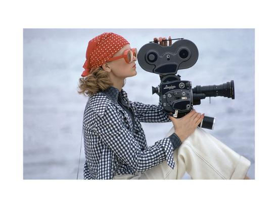 Side View of Model Holding a Movie Camera, Filming in Paradise Island, Bahamas-Gianni Penati-Premium Giclee Print