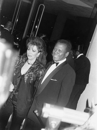 Sidney Poitier and Jackie Collins - 1990-Isaac Sutton-Photographic Print