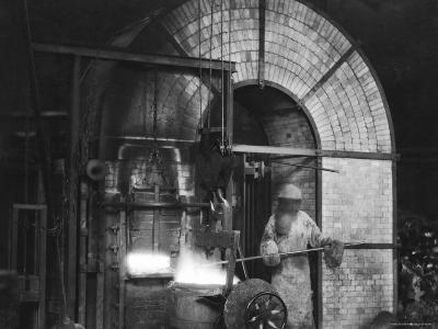 Siemens and Schukert Brass Foundry, Where Worker Has His Face Covered to Protect Against Fumes-Emil Otto Hopp?-Photographic Print