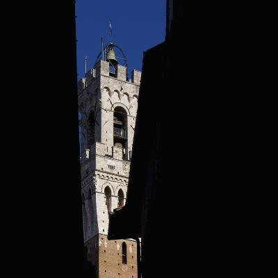 Siena Architectural Details. Glimpse of Crenellated Tower with Bell-Mike Burton-Photographic Print