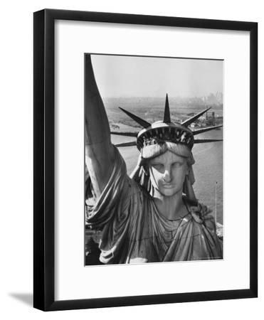 Sightseers Hanging Out Windows in Crown of Statue of Liberty with NJ Shore in the Background-Margaret Bourke-White-Framed Premium Photographic Print