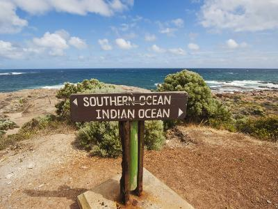 Sign Marking the Southern and Indian Oceans at Cape Leeuwin, Western Australia-Robert Francis-Photographic Print