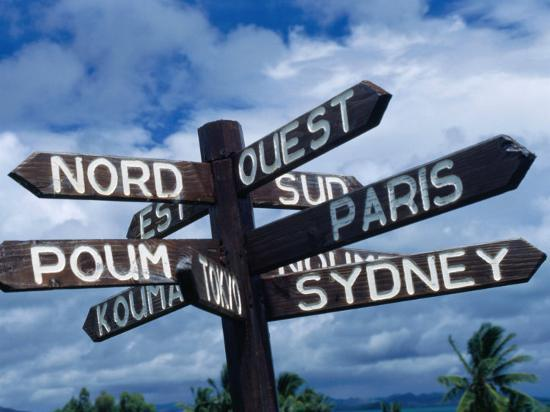 Sign Showing Directions to Other Cities in World, Koumac, New Caledonia-Jean-Bernard Carillet-Photographic Print