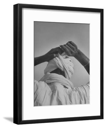 Sikh Man Demonstrating How He Finishes the Winding of His Traditional Turban around His Head-Margaret Bourke-White-Framed Premium Photographic Print