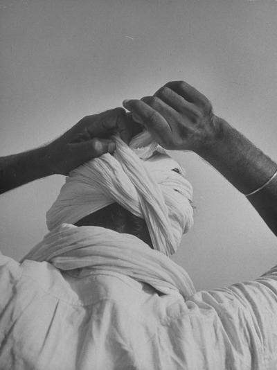 Sikh Man Demonstrating How He Finishes the Winding of His Traditional Turban around His Head-Margaret Bourke-White-Photographic Print