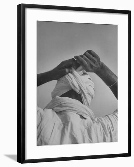 Sikh Man Demonstrating How He Finishes the Winding of His Traditional Turban around His Head-Margaret Bourke-White-Framed Photographic Print